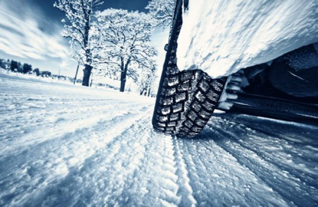 low angle image of car tire on snowy road